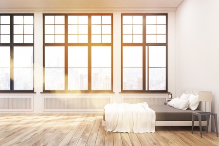 master bedroom: Side view of a master bedroom with a bed, two bedside tables and three large windows in a white wall. 3d rendering. Mock up. Toned image Stock Photo