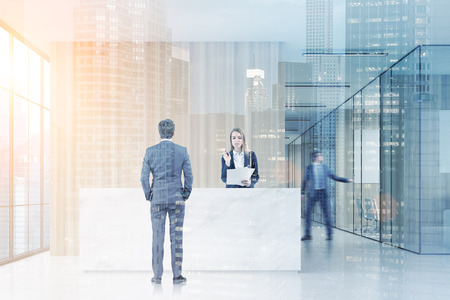 double exposure: Man standing near a reception desk talking to a receptionist. His colleague is closing a meeting room door. 3d rendering. Mock up. Toned image. Double exposure