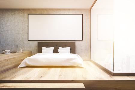 #70384575   Frontansicht Eines Home Office In Einem Schlafzimmer. Es Gibt  Ein Bett Mit Einem Tisch Links Davon Und Einem Gerahmten Horizontalen  Plakat.