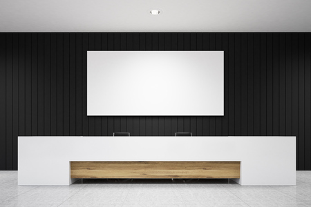 White reception counter with a wooden element is standing against a black wall with a poster hanging above it. 3d rendering. Mock up.
