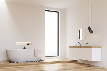 Corner of a bathroom with white walls and a narrow window. There is a white tub and a round mirror hanging above a sink. 3d rendering. Mock up.