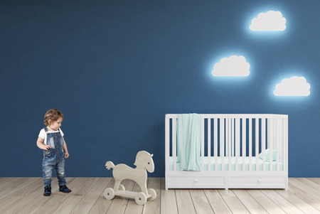 wooden horse: Little boy in a baby's room with a crib, cloud shaped lamps and a toy horse. Blue walls. Concept of minimalism. 3d rendering. Mock up.