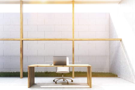 lawn chair: Front view of a CEO office with large glass and wooden wall. Sky is seen through the opening in the roof. Desk with a laptop and a chair. 3d rendering. Mock up. Toned image Stock Photo