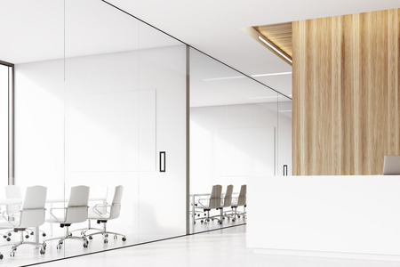 Side view of a company corridor with a reception desk, a laptop standing on it and a row of conference rooms with glass walls. 3d rendering. Mock up. Stock Photo - 71425905