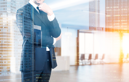 double exposure: Close up of a businessman in a suit standing in his company office with a reception counter and a meeting room with glass walls. 3d rendering. Toned image. Double exposure