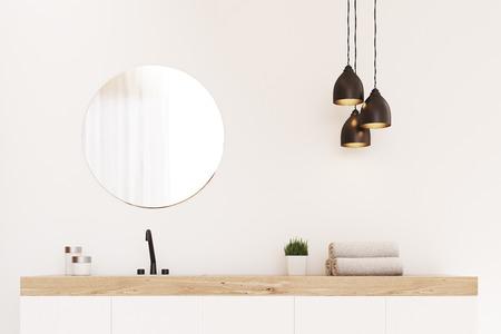 Primo piano di un lavandino del bagno, uno specchio rotondo e un asciugamano. C'è un elemento di decorazione in legno. Il concetto di lusso moderno. rendering 3d. Modello. Archivio Fotografico - 71970302