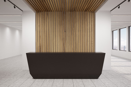 Side view of a new office lobby with wooden decoration elements, black and massive reception counter, an office with glass walls, clean and bright. 3d rendering. Mock up.