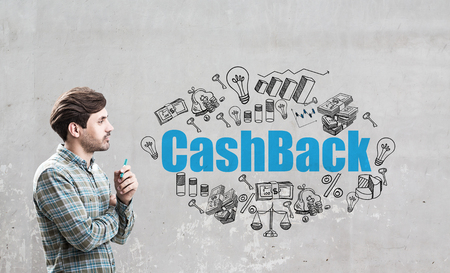 repossessing: Side view of a man in a checkered shirt standing near a concrete wall with a blue cash back sketch drawn on it.