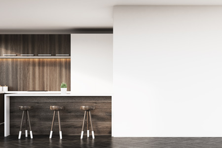 Close up of kitchen bar made of dark wood and three stools standing near it. There is a white cupboard and a blank wall fragment. 3d rendering. Mock up.