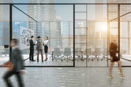 walled: Glass walled office with businesspeople in formal clothes walking and discussing work issues. There is a motivational poster on one of the walls. 3d rendering