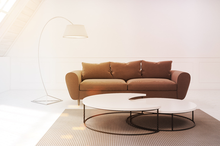 Beige sofa and a table are standing in a room in an attic. There is a narrow round table and a carpet. 3d rendering, mock up