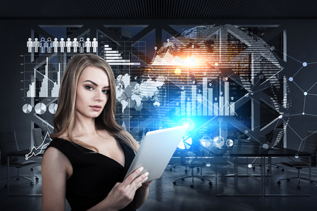 glassboard: Portrait of a businesswoman with a tablet computer standing on a spaceship deck with graphs drawn on a glassboard. Toned image. Elements of this image furnished by NASA