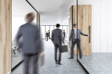Rear view of businesmen in suits walking in an office corridor with wood and glass decoration elements. 3d rendering Stock Photo