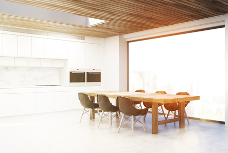living room wall: Corner of a kitchen with a long table and six black chairs. There is a white counter in the background. 3d rendering, toned image