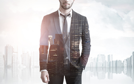 law suit: Close up of an unrecognizable bearded businessman standing against a cityscape. Double epxosure. Stock Photo