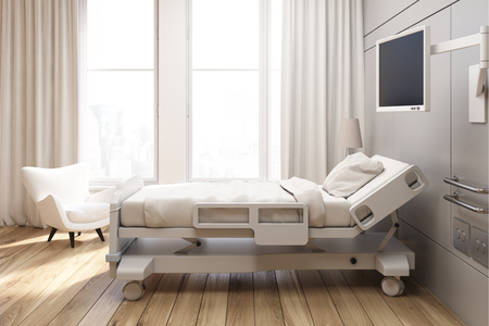 Side view of a gray walled hospital ward with a bed, a tv set, a white armchair and curtains on large windows. 3d rendering, Mock up Banco de Imagens