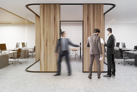 People working in an open office with a wooden aquarium with conference room inside. Concept of a modern workplace. 3d rendering Stock Photo