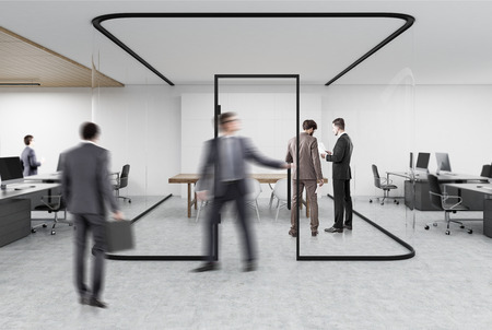 people working in an open office with a glass aquarium with