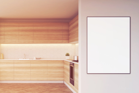 countertop: Poster in a wooden kitchen. It is hanging on a light gray wall. There are wooden countertops. 3d rendering, mock up, toned image.