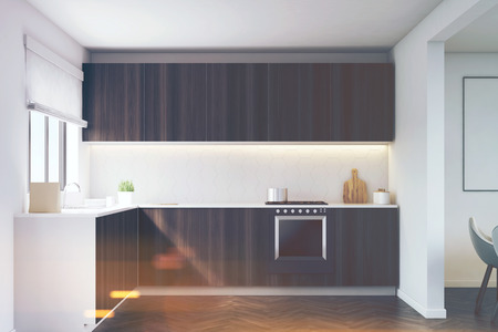 apartment suite: Kitchen counter made of dark wood and a built in oven. Large window in the wall. 3d rendering, toned image