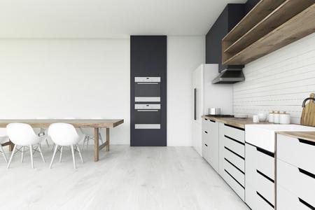 Charming Kücheninnenraum Mit Konkretem Boden, Zwei Öfen, Ein Langer Holztisch Mit  Stühlen Und Weißen Countertops