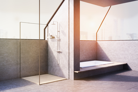 Corner of a bathroom with a bath tub sunk in the floor and a square shower cabin behind a wall. 3d rendering, toned image