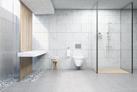 Bathroom interior with gray brick walls, a shower cabin with glass wall, a toilet and a double sink. 3d rendering.