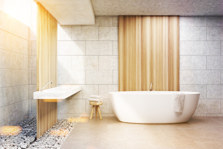 Front view of a bathroom interior with gray brick and wooden walls, a white bath tub and a double sink. 3d rendering, toned image