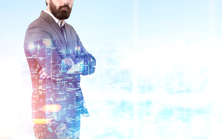 Unrecognizable bearded businessman in is standing with crossed arms against a night city panorama. Toned image, mock up, double exposure