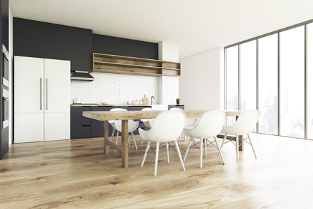 countertop: Side view of a kitchen interior with a wooden floor, a long wooden table with white chairs and a large fridge. 3d rendering