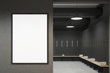 Front view of a gray locker room with benches along the rows of lockers. There is a vertical framed poster on a wall. 3d rendering, mock up Foto de archivo