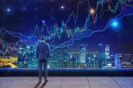international internet: Rear view of a man standing on the roof with hands in pockets and looking at glowing graphs in the night sky Stock Photo