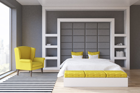shiny floor: Front view of a gray wall bedroom with a panoramic window and a yellow armchair standing beside a double bed. 3d rendering. Stock Photo
