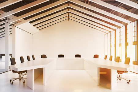 meet up: Close up of a house framed conference room with a white floor and walls and three tables with chairs around them. 3d rendering, toned image.