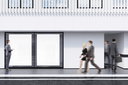 second floor: Business people passing by a shop window with two posters and a white balcony on the second floor. Concept of promotion. 3d rendering, mock up