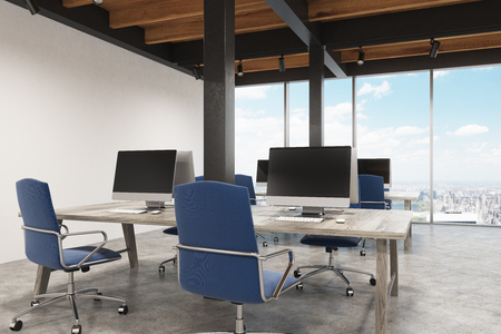 Office interior with metal pillars, two computers standing on the desk and a panoramic cityscape. 3d rendering, mock up Stock Photo