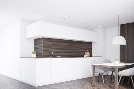 countertop: Corner of a kitchen interior with dark wooden walls, white countertop and a dining table with four chairs. 3d rendering, mock up Stock Photo