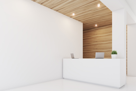 Side view of a reception desk standing in an office with light wooden wall elements. 3d rendering, mock up Stock Photo