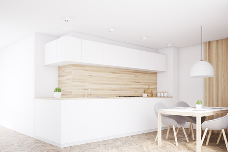 countertop: Corner of a kitchen interior with light wooden walls, white countertop and a dining table with four chairs. 3d rendering, mock up