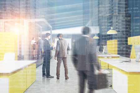Business people in an office interior with rows of white and yellow tables, computers standing on them and a whiteboard hanging on a brick wall. 3d rendering, toned image, double exposure