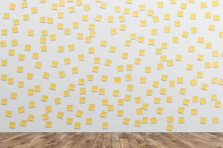 White wall is covered by many yellow sticky notes. There is a wooden floor in the room. 3d rendering. Stock Photo