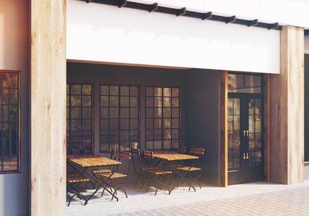 cappucino: Side view of a cafe exterior with gray walls and two wooden tables with chairs standing near a door. 3d rendering, toned image