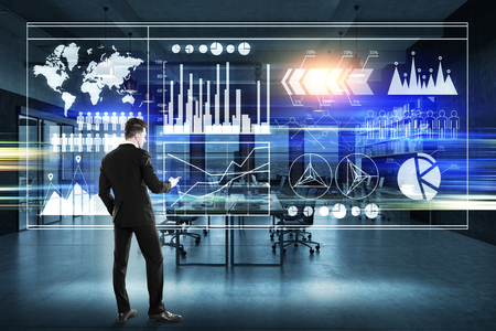 Rear view of businessman in a suit looking at graphs on a glassboard. Elements of this image furnished by NASA. 3d rendering, toned image Stock Photo