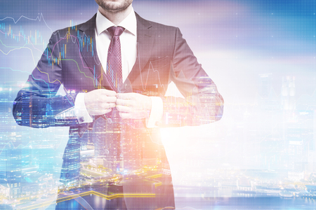 Portrait of an unrecognizable businessman buttoning his suit while standing against a city panorama. Toned image, double exposure