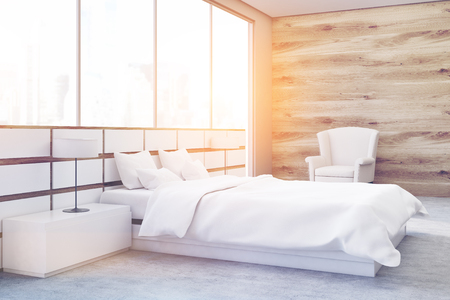 matrimonial: Side view of a minimalistic bedroom interior with a double bed standing near a large panoramic window. 3d rendering, toned image Stock Photo
