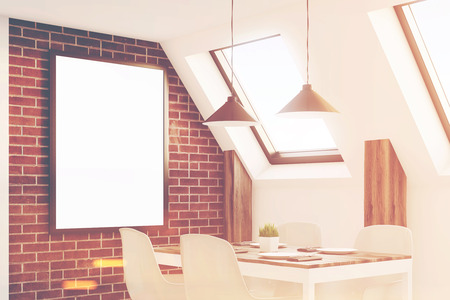 condo: Close up of an attic kitchen with brick walls, a long wooden table and a framed vertical poster. 3d rendering, mock up, toned image Stock Photo