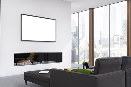 Corner of a living room with a black sofa, a fireplace, a framed horizontal poster hanging above it and panoramic windows. 3d rendering, mock up