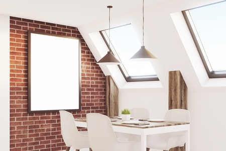 Close up of an attic kitchen with brick walls, a long wooden table and a framed vertical poster. 3d rendering, mock up