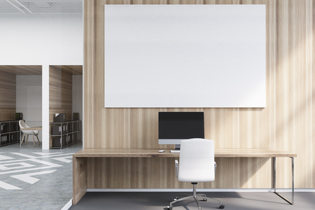 Office cubicles in an office with white and wooden walls. There is a blank horizontal picture, a desk with a computer and a chair. Front view. 3d rendering mock up Stock Photo