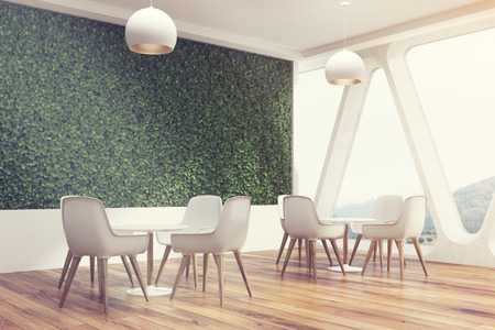 side view of an office cafe interior with a large grass wall stock photo picture and royalty free image image 79037195 - Large Cafe Interior
